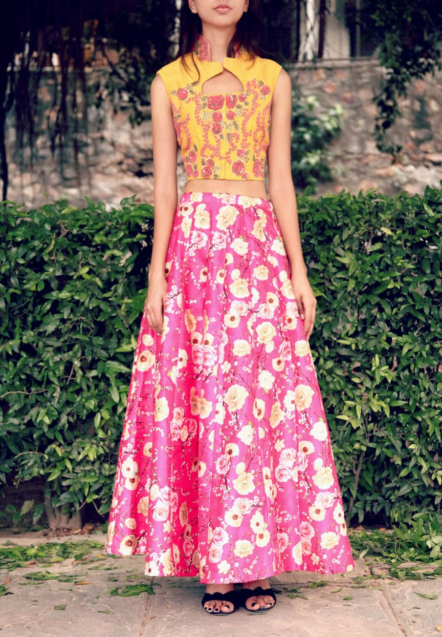 Yellow crop jacket with pink floral printed skirt.